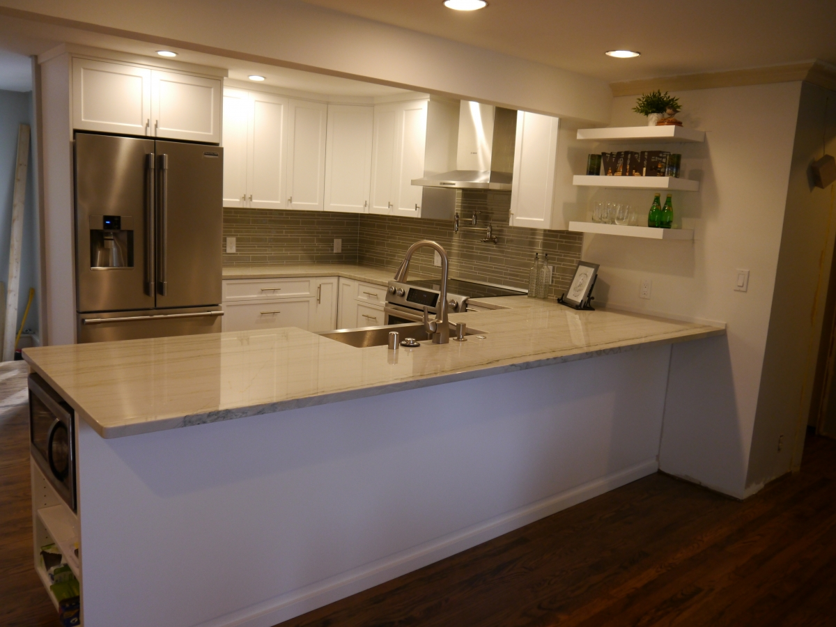 After   Kitchen From Main Room. Satin White Foil Cabinetry, Granite  Countertops With Hidden Supports By Federal Brace, And Full Height Glass  Tile Backsplash