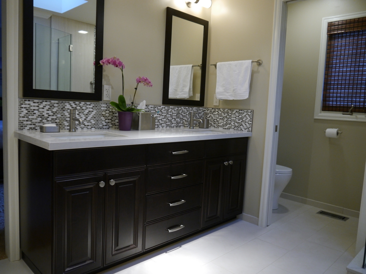 Maple With Dark Stained Cabinet Quartz Countertop And Framed Mirrors