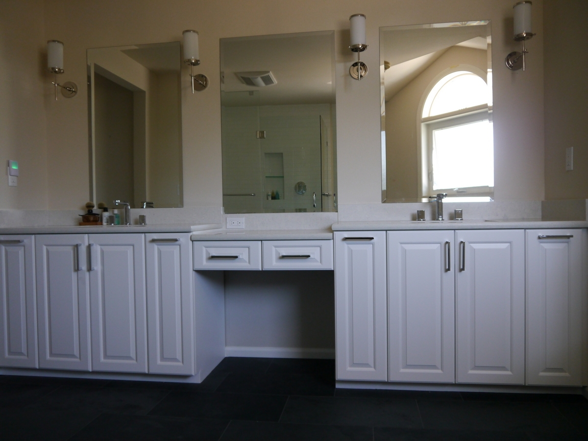 White Painted Cabinet With Quartz Countertop, Vanity Organizers And Built In  Makeup Vanity, And Three Beveled Mirrors