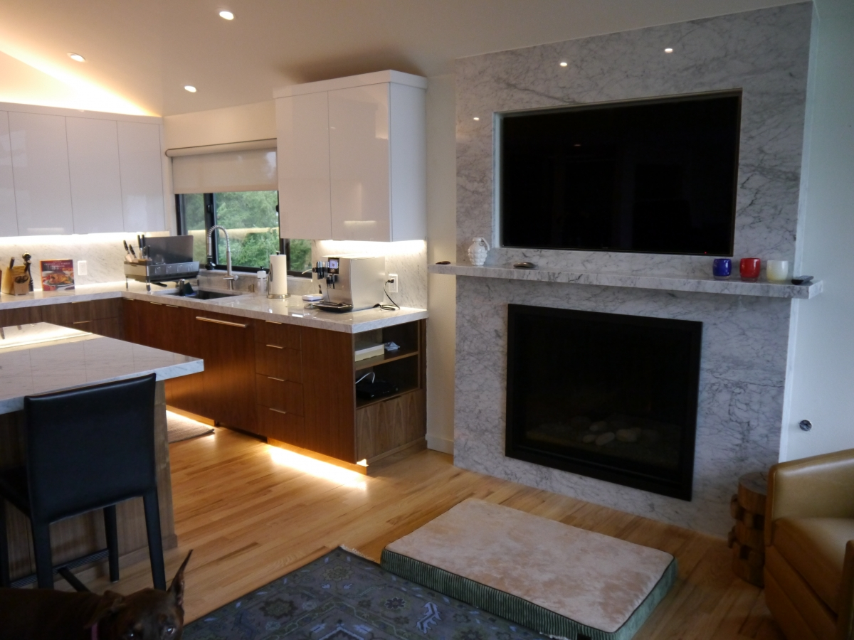 White Acrylic Upper Cabinets With Walnut Lower Marble Countertops And Backsplash Built In Gas Fireplace Television