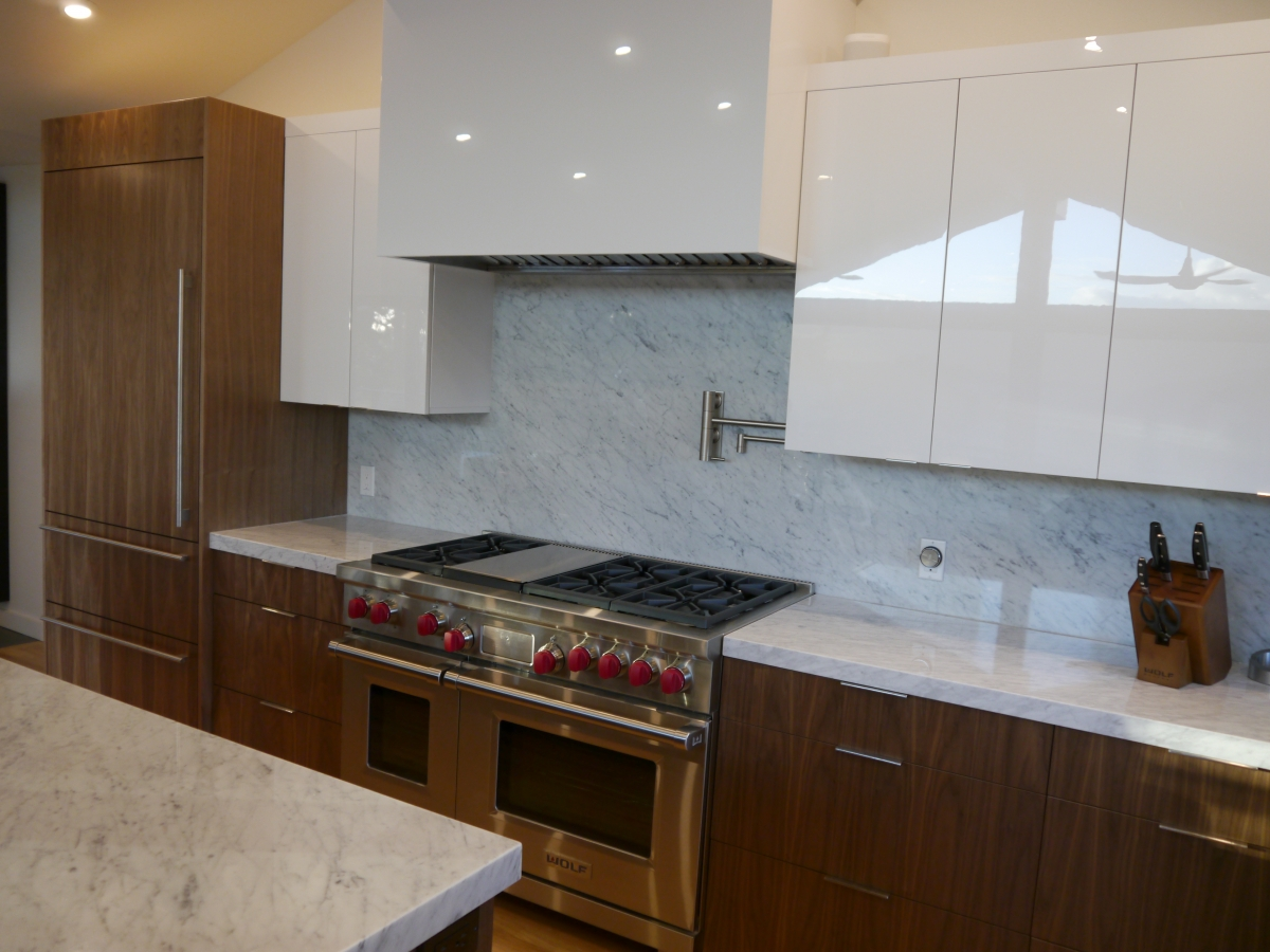 White Acrylic Upper Cabinets With Walnut Lower Cabinets, Marble Countertops  And Backsplash