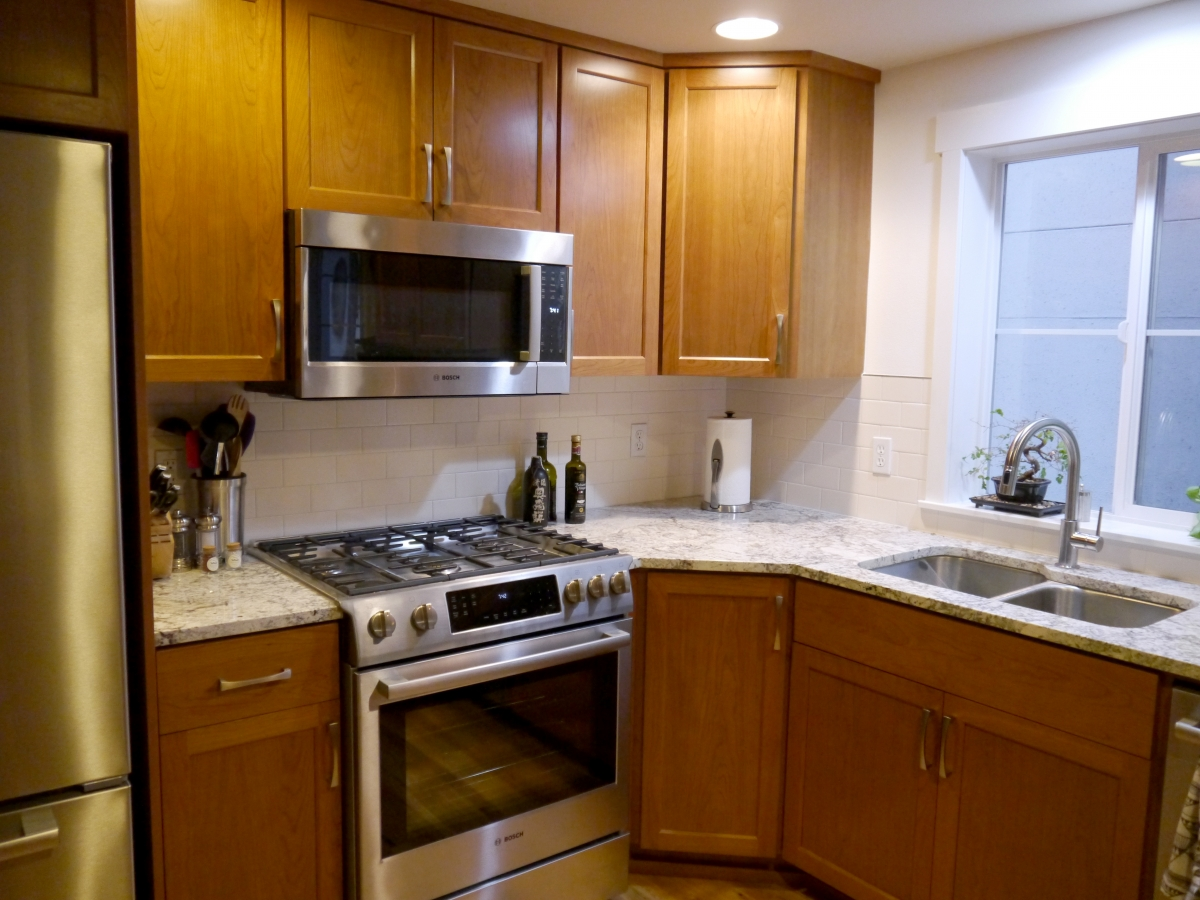 After   Shaker Style Select Cherry Stained Cabinet Doors, Granite  Countertops With Undermount Sink And Full Height Tile Backsplash