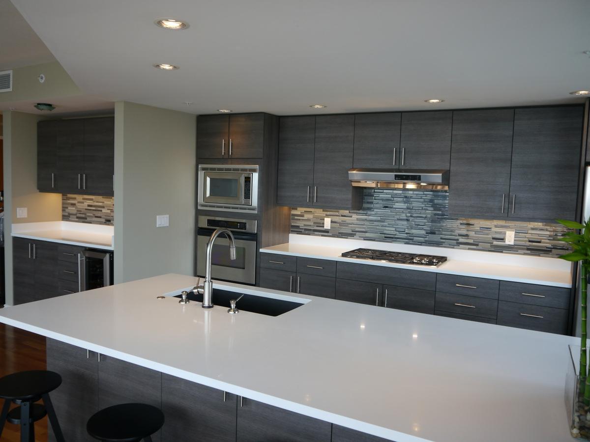 Seattle Condo Modern Kitchen Reface. Textured Innovative Design Series cabinets, new island, quartz countertops, linear glass blend tile backsplash, ...